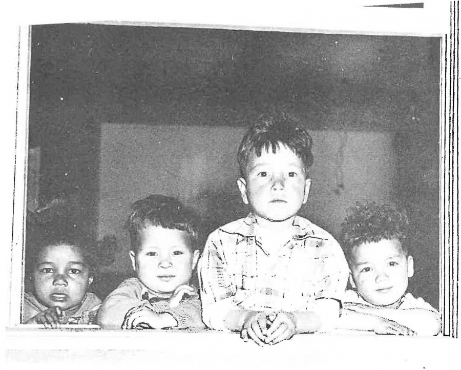 A black and white image of four young children