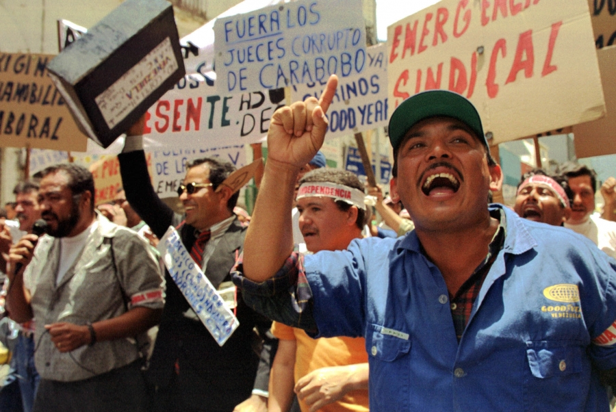 Protesters shout out for the end of political and economic corruption in front of the Venezuelan Congress, September 1999.