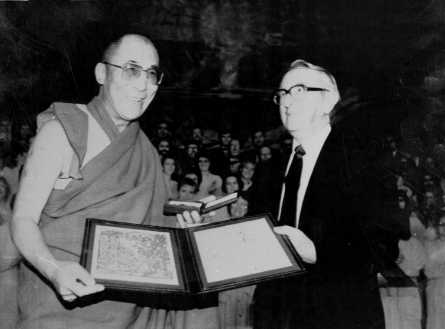 The Dalai Lama holds the Nobel Peace prize in a black and white photograph