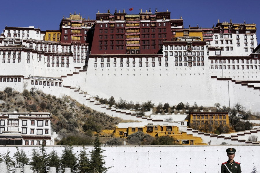 A Chinese guard stands in front of the Potala Palace