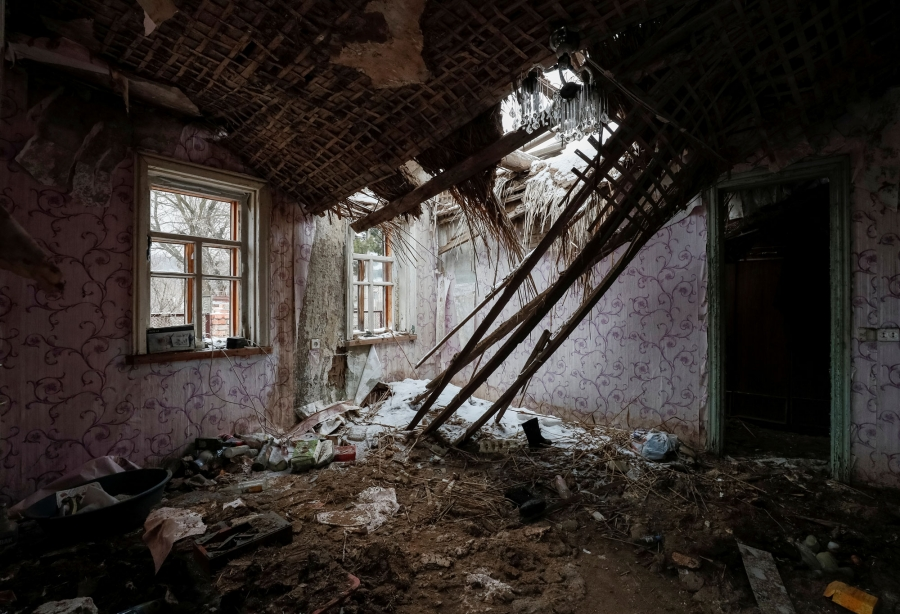 A house in the village of Zaitseve is shown with the roof caved in after a shelling.