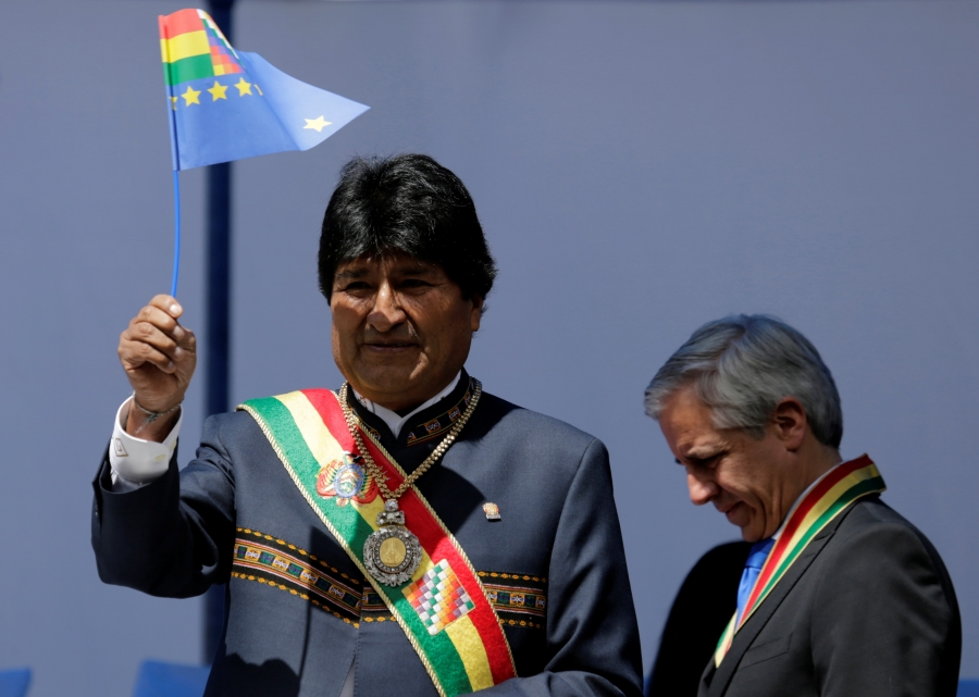 Bolivia's President Evo Morales waives a small Bolivian flag