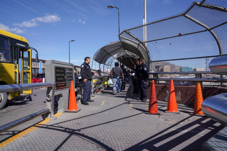 Two Mexican border security officers are show at the entryway to the Mexico-US bordercrossing