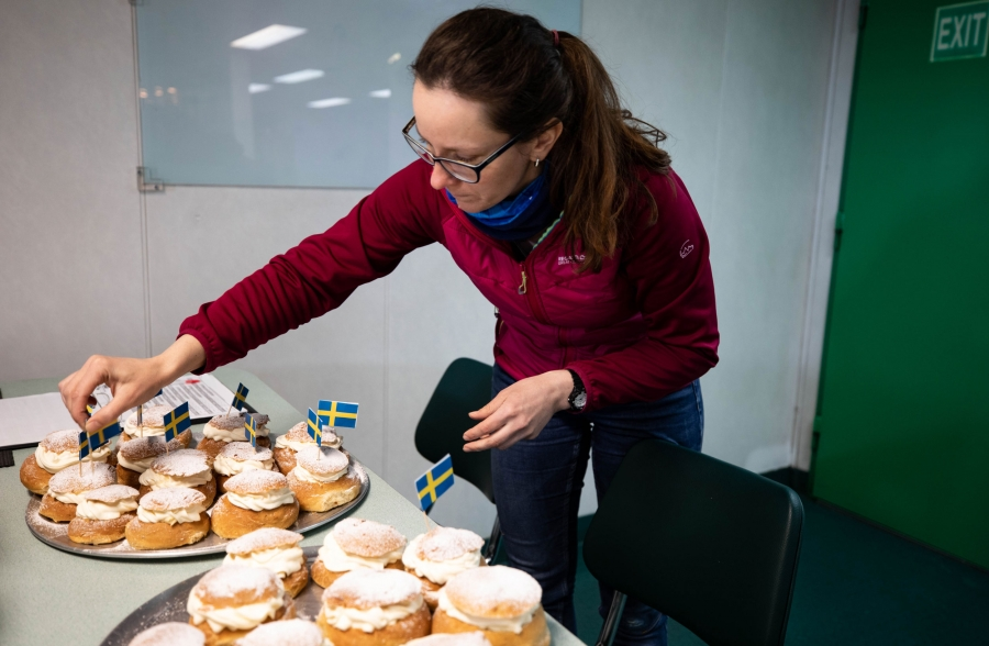 Aleksandra Mazur is shown putting Swedish flags in Mardi Gras pastries.