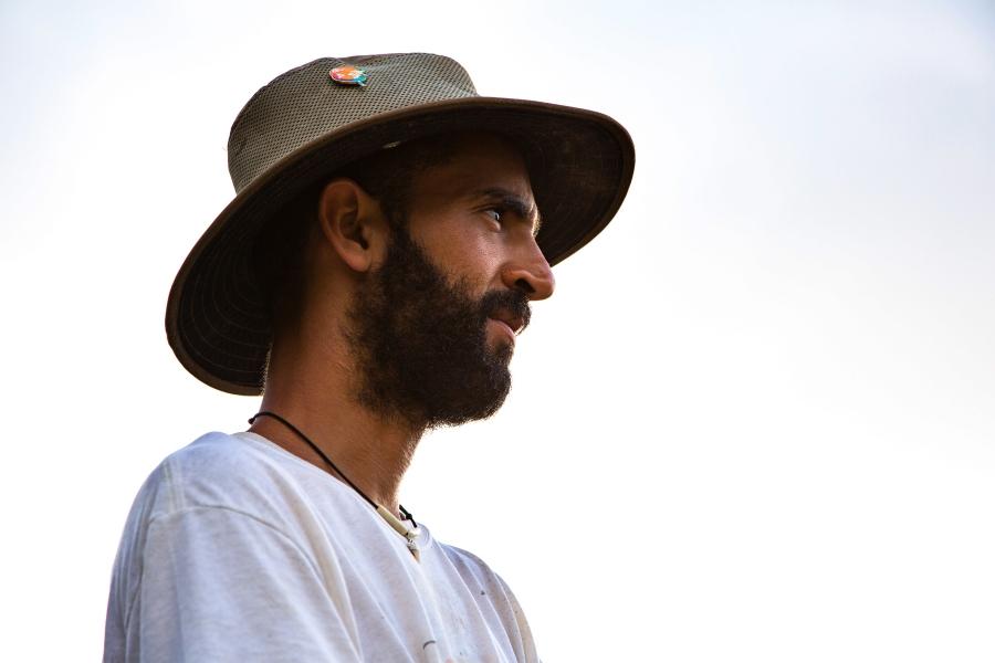 A portrait of Franco Marcano wearing a hat.