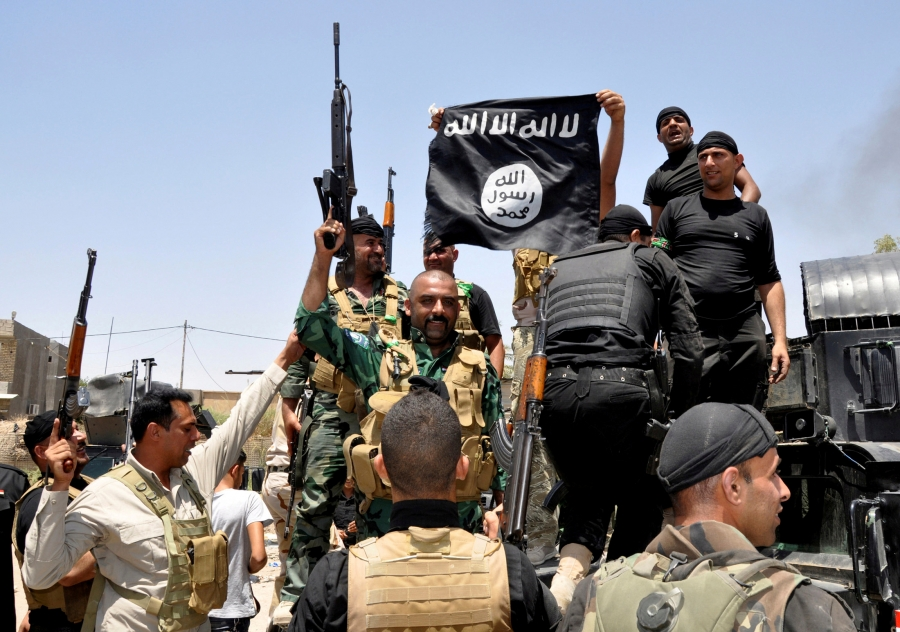 men on military truck capture ISIS flag