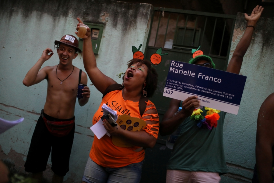 street protester in brazil dresses as orange during carnival