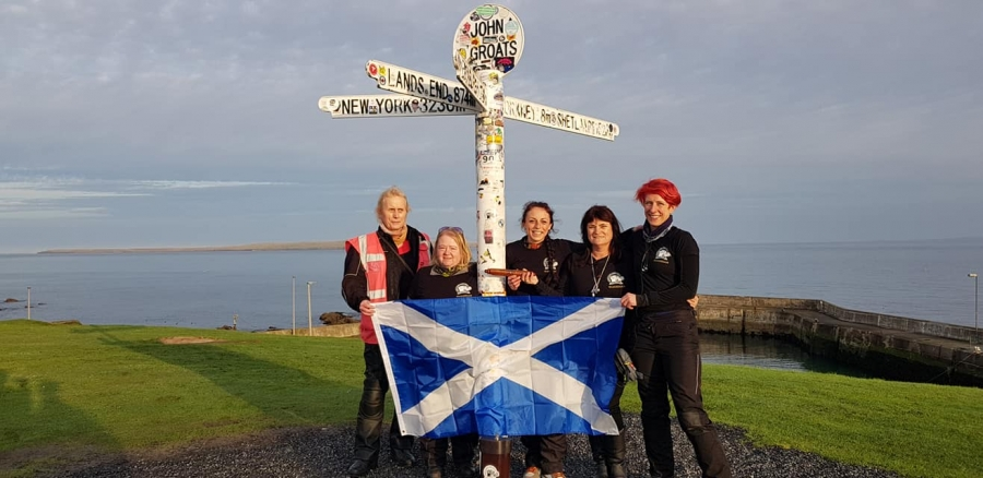 Hayley Bell (third from right), Colette Edeling (second from right) and other riders in John O'Groats, Scotland, the starting point of the relay.
