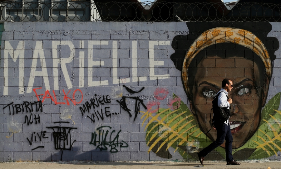 Mural of Marielle Franco's face against grey background.