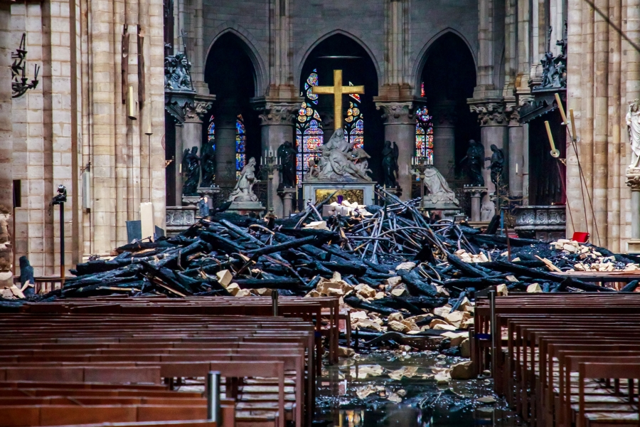 Blackened rubble fills the front of a church