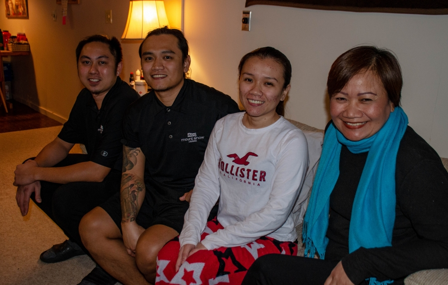 The Tamayo family poses for a group photo at their winter apartment in southern Vermont. They had been planning to move to Cape Cod in mid-April for their summer jobs. From left: Smart Sabangan, Rayben Tamayo, Yazel Ruth Tamayo-Sabangan, and Yolanda Tamay