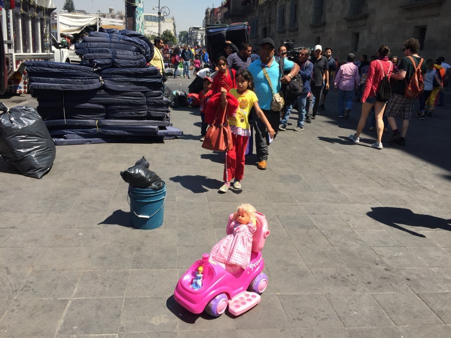 children board a bus in mexico city