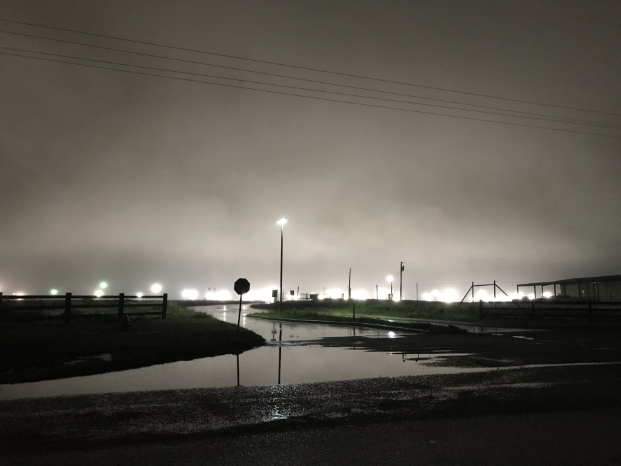 Flood lights at the nation's largest migrant family detention facility illuminate the night sky near the south Texas town of Dilley.