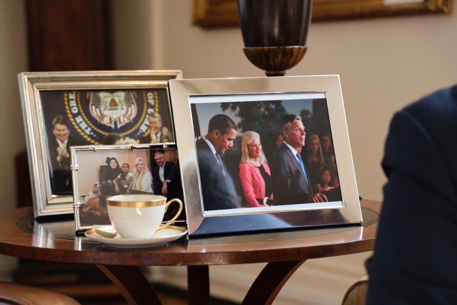 A side table with photos, including one with President Barack Obama