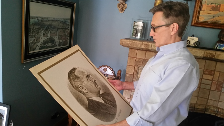Clifton Daniel holds a picture of President Truman