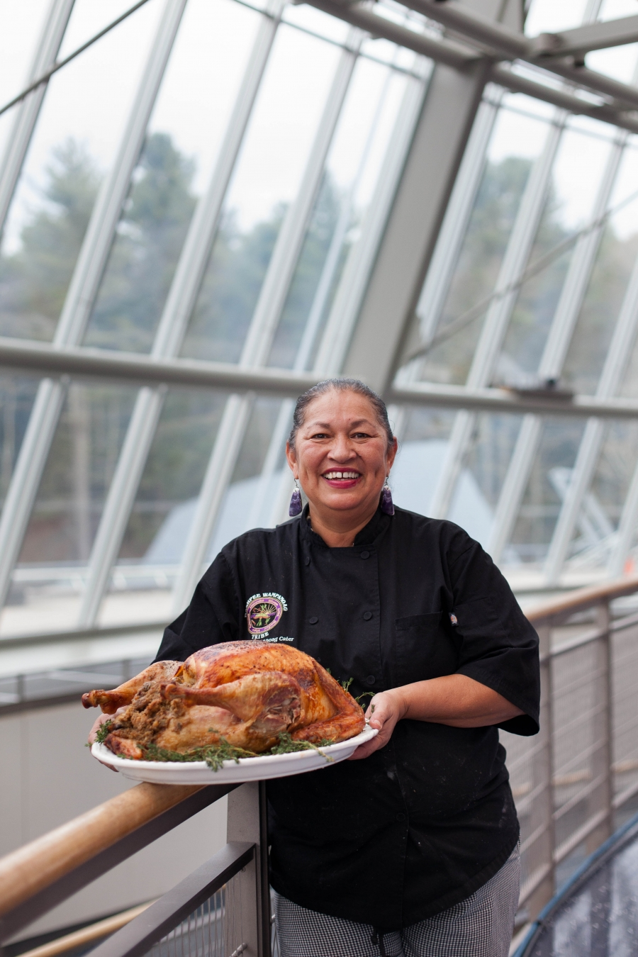 """Chef Sherry Pocknett of the Mashpee Wampanoag Nation prepared the FEAST for the second year in a row. """"I enjoy welcoming you guys into my life, into the way I grew up, how we eat,"""" she said to crowd before dinner was served."""