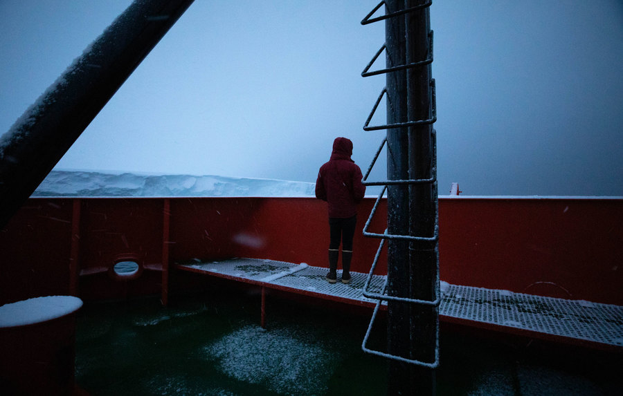 Oceanographer Peter Sheehan is shown with his jacket hood over his head while looking out at Thwaites.