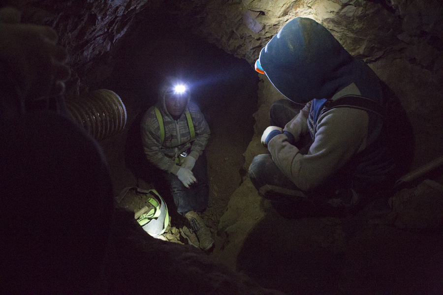 Three miners use hand tools to dig for gold 70 feet down a mineshaft north of Ulaanbaatar. They're part of a small-scale mining cooperative that's chosen not to use toxic mercury in their gold processing.