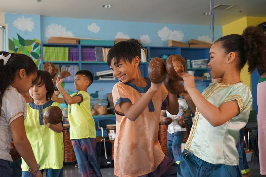 Irish American music teacher Rita Laughlin teaches kids in Lowell, Massachusetts, how to play traditional Cambodian instruments. Here, fourth graders practice the Coconut Dance in costume.