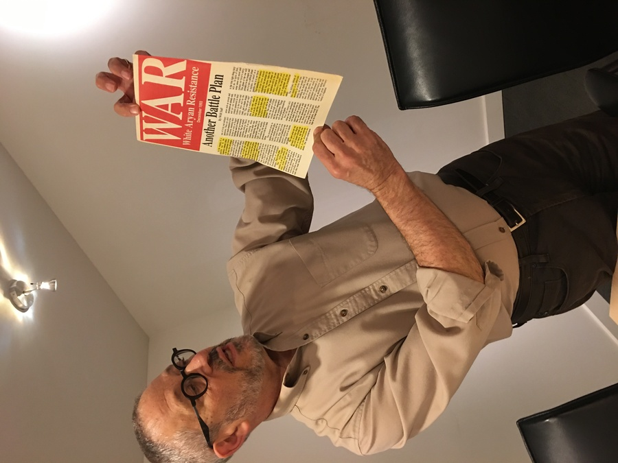 Steven Wasserstrom, a professor of Judaic studies and the humanities at Reed College, holds a piece of documentation collected by the Coalition for Human Dignity in Portland.
