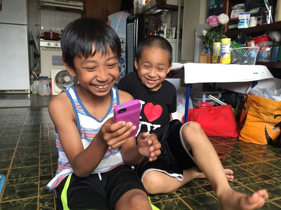 Nine-year-old Maddox uses an app to help translate the words he doesn't know in Khmer when he accompanies his grandmother to her doctor's visits, where she's treated for symptoms of PTSD.