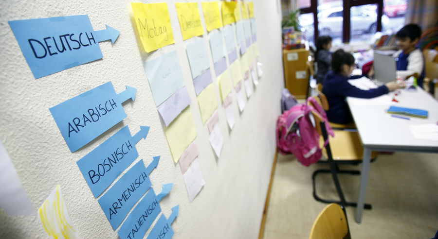Berlin now has about 1,100 welcome classes in its more than 600 schools. Here, notes on a wall help students from different countries learn German at the Sankt Franziskus school, Jan. 22, 2016.