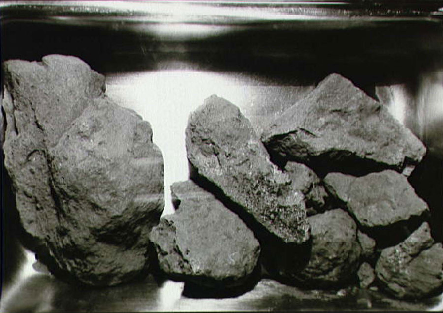 Several rocks from the surface of the moon are shown next to each other.