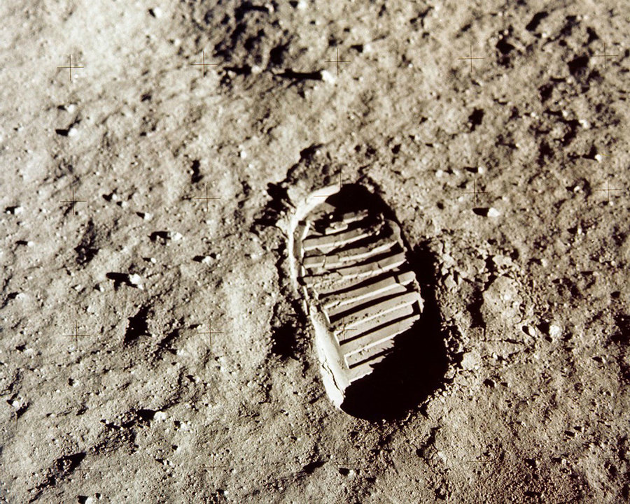 The oval tread of an astronaut's footprint is shown on the the lunar soil.