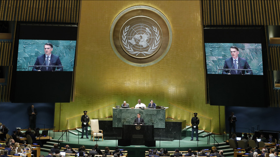 A man at a podium under the UN symbol