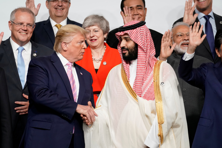 US President Donald Trump shakes hands with Saudi Arabia's Crown Prince Mohammed bin Salman during family photo session with other leaders and attendees at the G20 leaders summit
