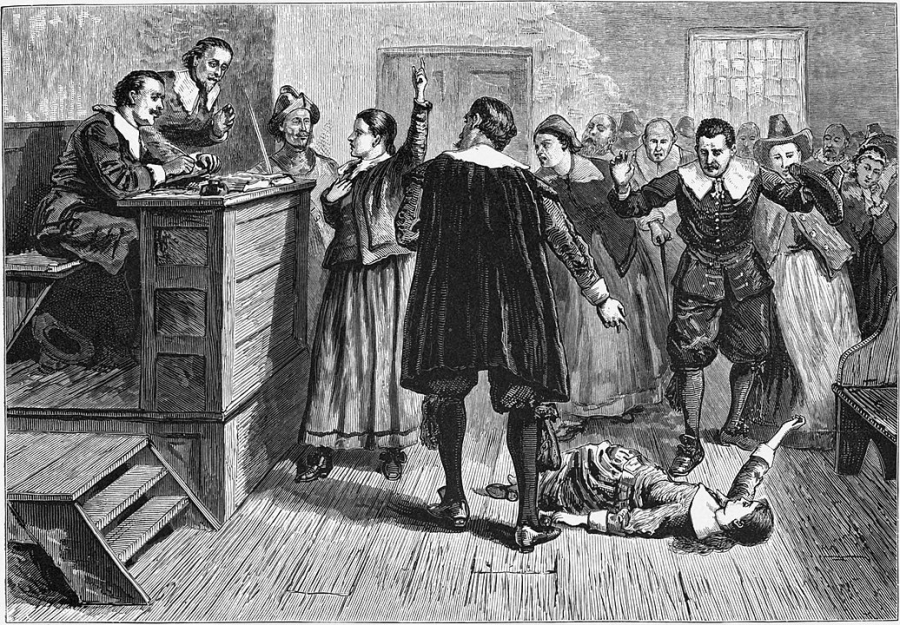 An illustration of a woman in a courtroom surrounded by men.