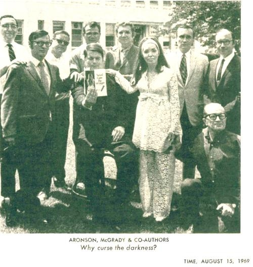 Some of the co-conspirators pose outside of the Newsday headquarters.