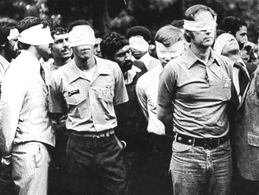 Blindfolded US hostages and their Iranian captors outside the US Embassy in Tehran, Iran, 1979.