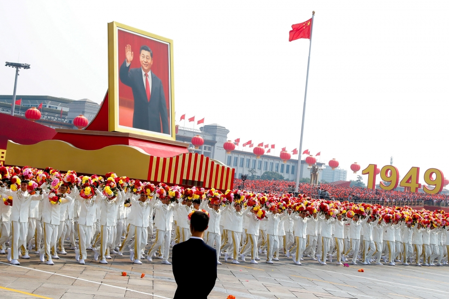 A float carrying a portrait of Chinese President Xi Jinping moves through Tiananmen Square