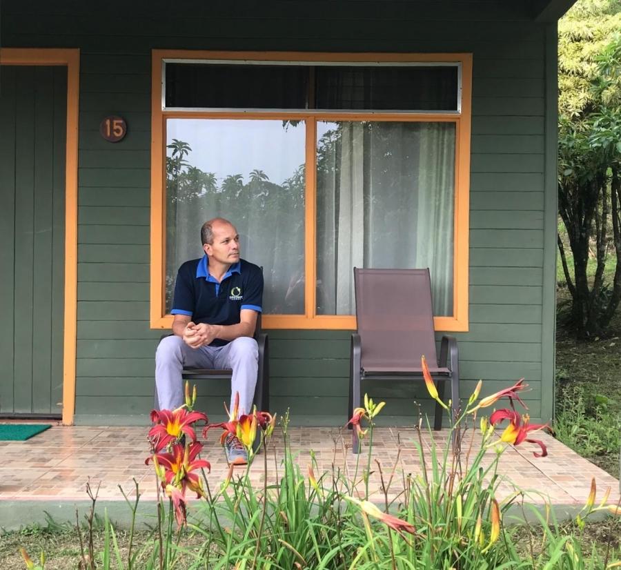 A man sits on a porch