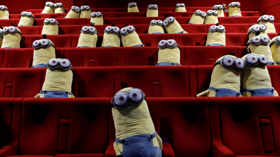 Stuffed Minion dolls are seen in theater seats