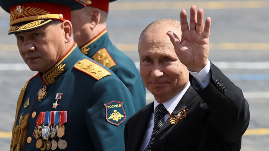 President Vladimir Putin waves