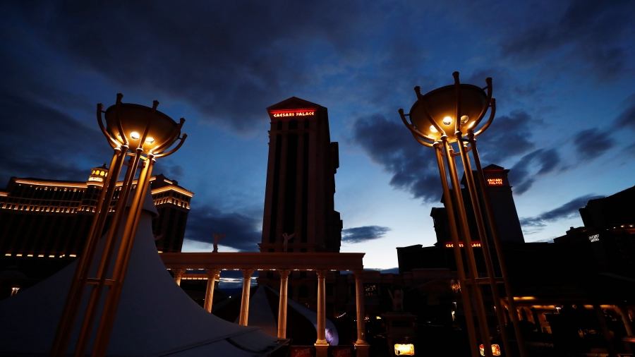 The closed Caesars Palace Las Vegas Hotel and Casino sign is seen illuminated as the spread of coronavirus disease (COVID-19) continues, on the Las Vegas strip.