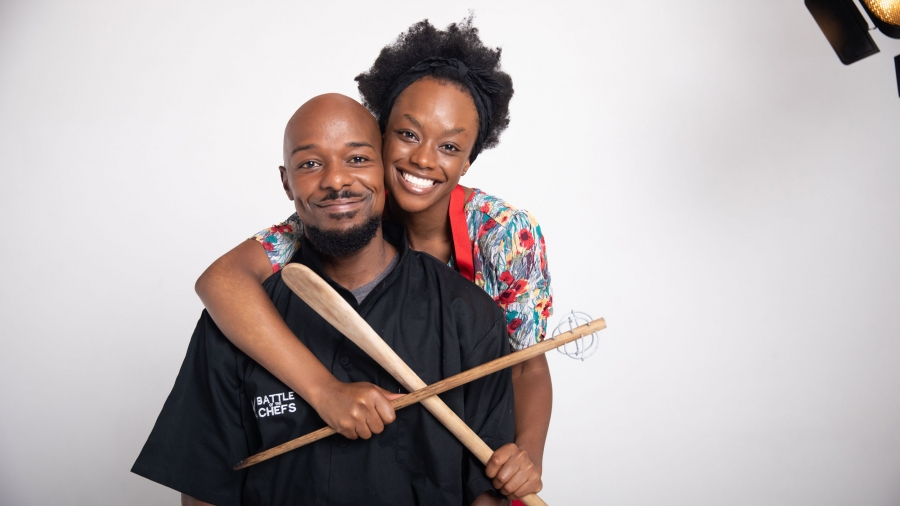 """A black man and a black woman pose in a hug for a publicity photo of the film """"Cook Off"""""""