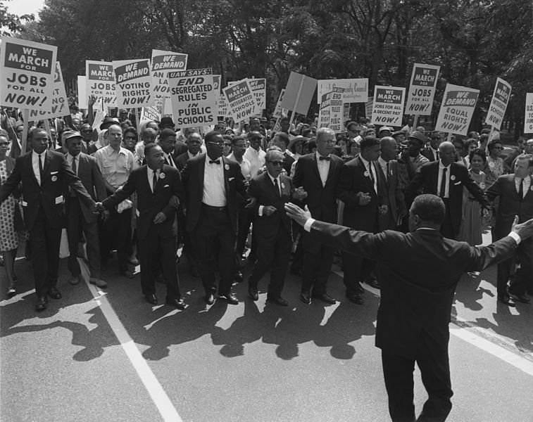 Leaders at the head of the Civil Rights March on Washington, DC, wearing suits and carrying signs.