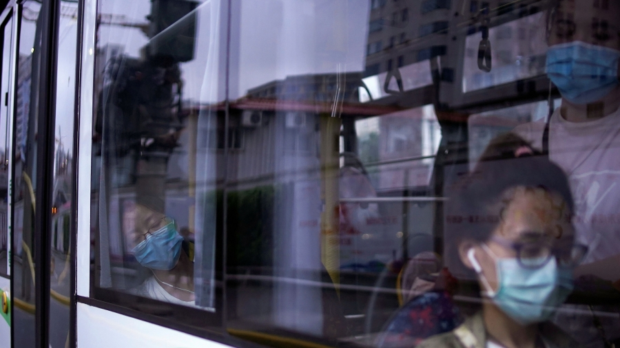 Women wearing protective face masks are seen in a bus, following the coronavirus disease (COVID-19) outbreak, in Shanghai, June 9, 2020.