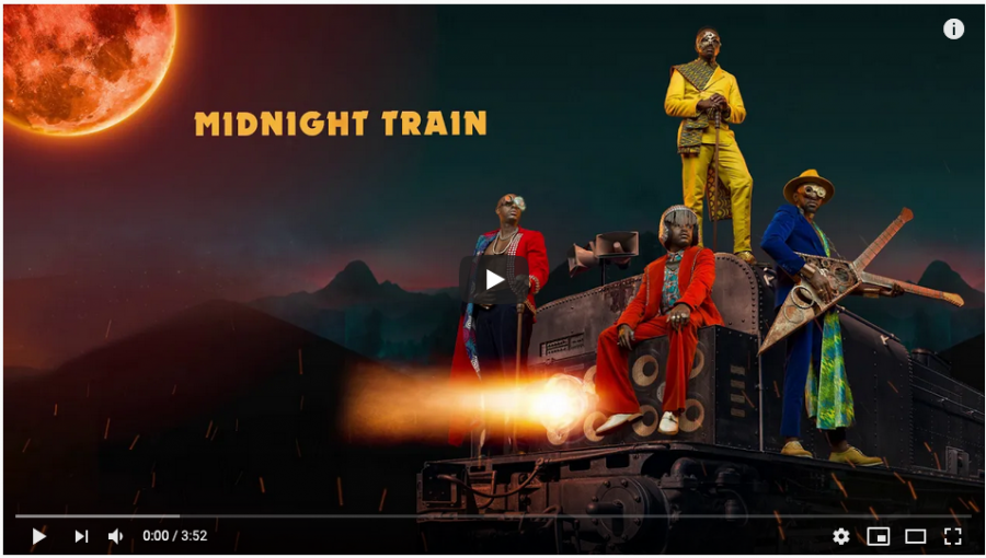 Four musicians on a train-like construction in an album cover for Midnight Train