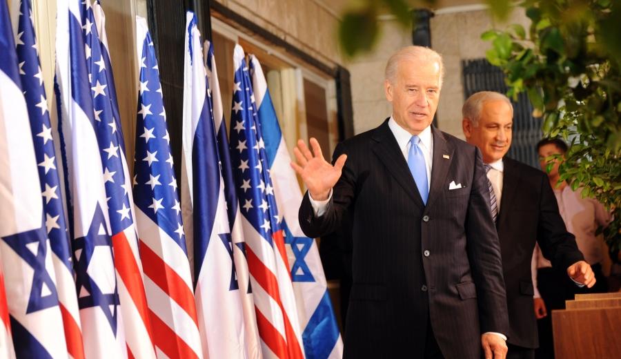 VP Joe Biden with Israeli PM Benjamin Netanyahu on a stage with US and Israeli flags
