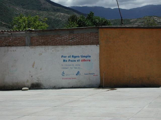 A stenciled message displayed on a concrete wall