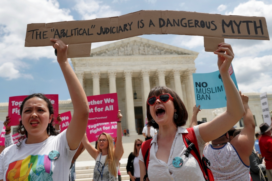 Two woman protestors outside the Supreme Court.