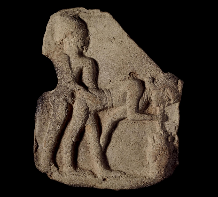 A stone carving of two people.