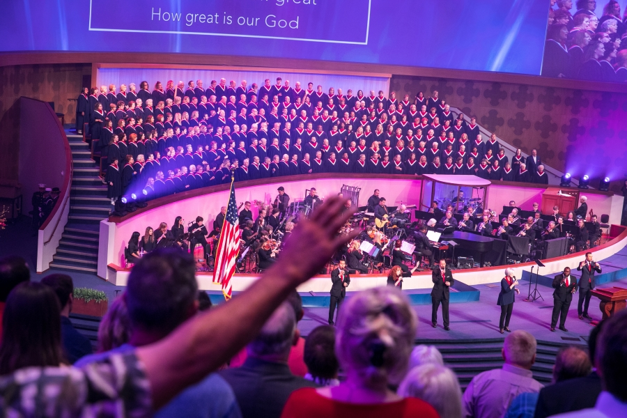 A choir at a church service from the view of the audience.