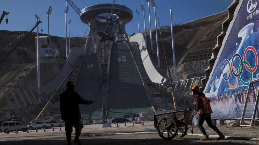 Laborers work at the construction site of the ski jump arena of the 2022 Winter Olympics in the Chongli district of Zhangjiakou, Hebei province, China, Oct. 29, 2020.