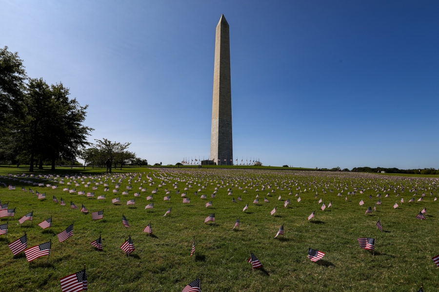 The Washington Monument surrounded by small flags in the ground around it, in memory of people who died from the coronavirus pandemic.