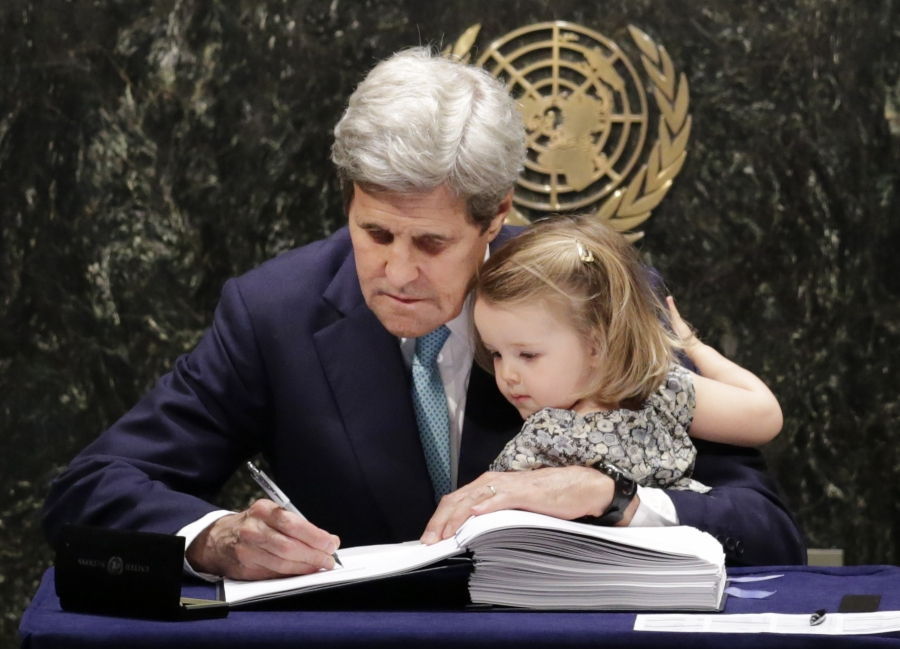 John Kerry and his cute granddaughter at the UN, where he is signing the treaty